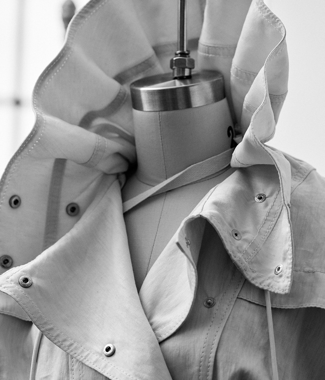 TRENCH COAT BEING ALTERED