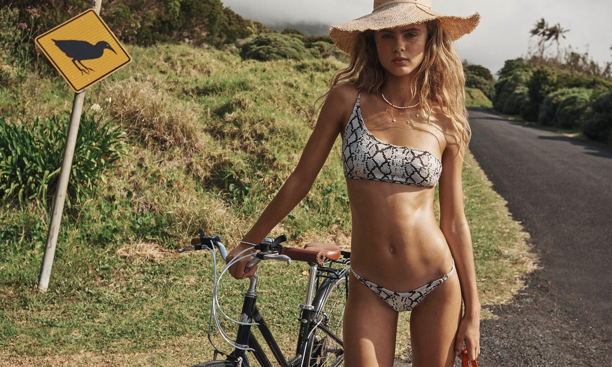 Olivia wears Fiesta 1 Shoulder Bikini Snake Jaquard Straw Travel Hat Natural