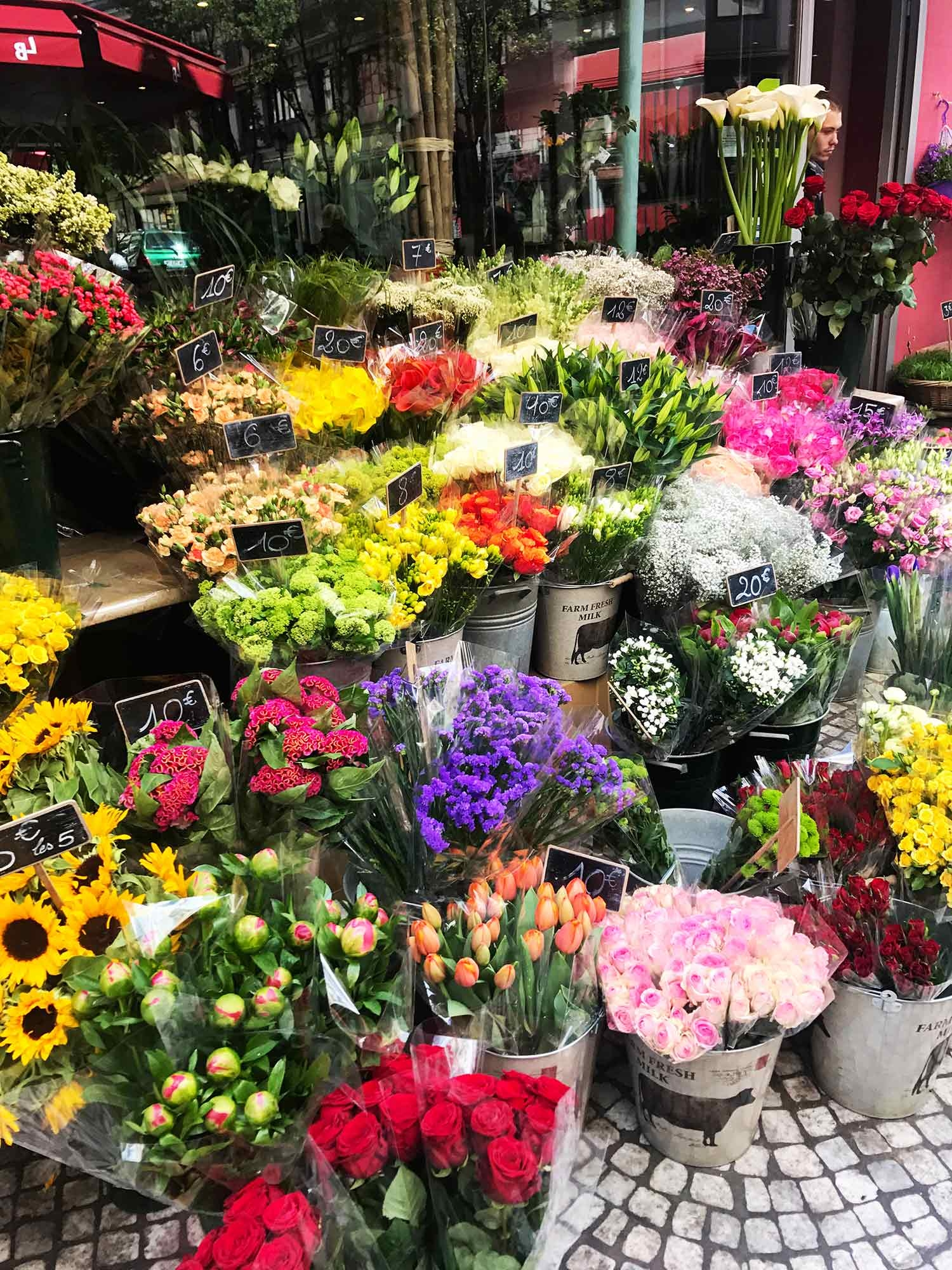 Bunches of flowers being sold street-side. December 2018
