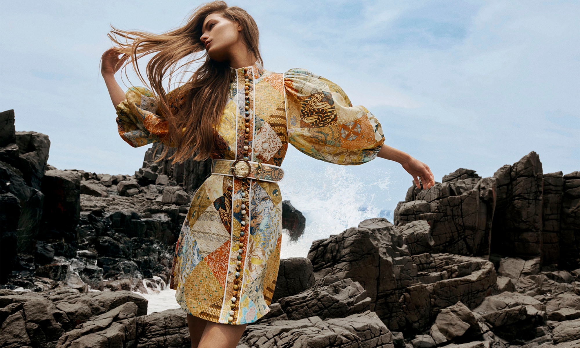 WOMAN STANDING ON THE ROCKS BY THE OCEAN WEARING 7935DBRI Brightside A-Line Mini, Batik Patch
