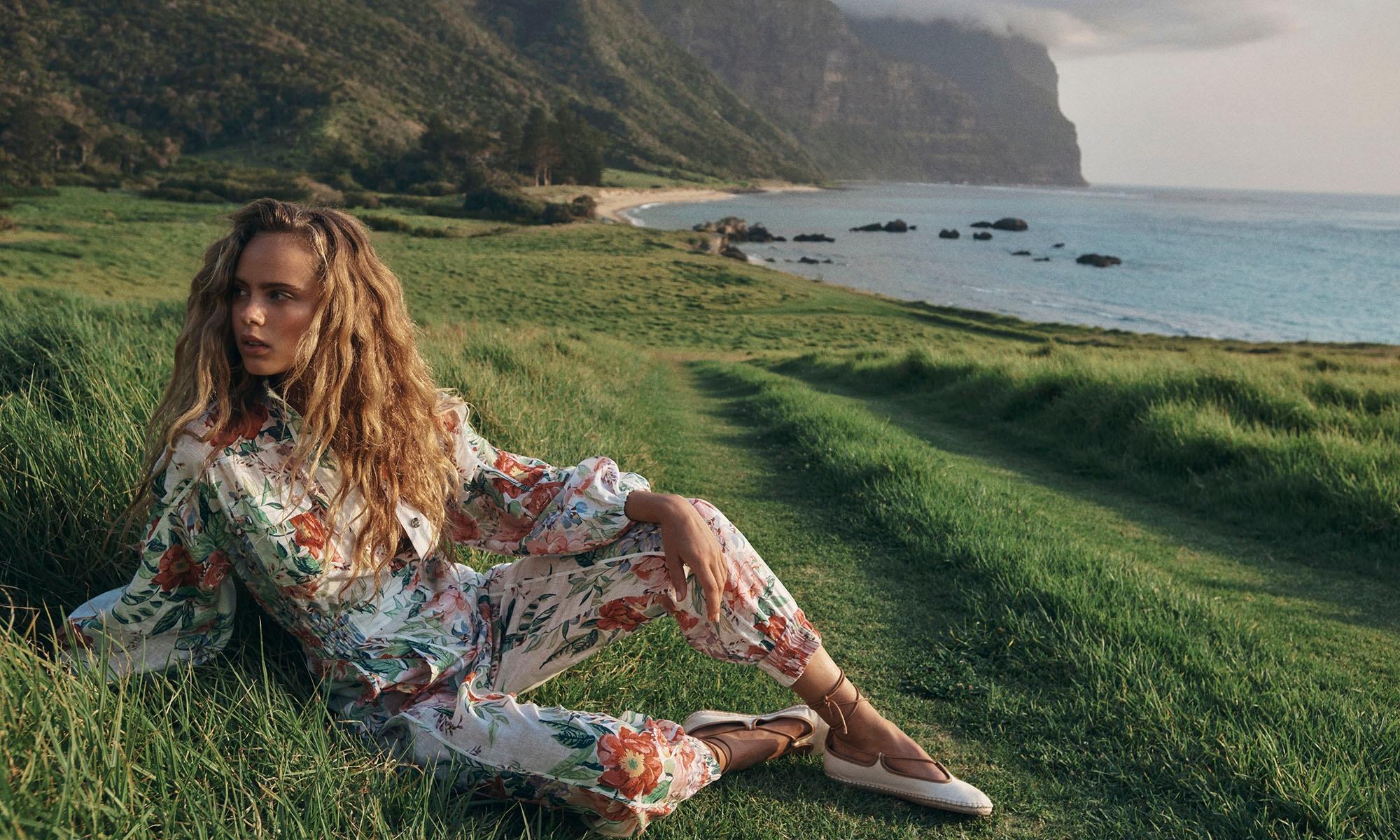 Olivia wears 8418UBTD Bellitude Boilersuit Ivory Floral 3145SS20 Canvas Espadrille Natural