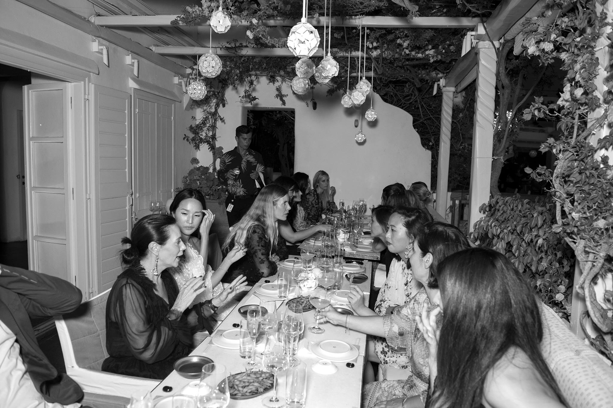 Our dinner party guests at the table chatting amongst themselves