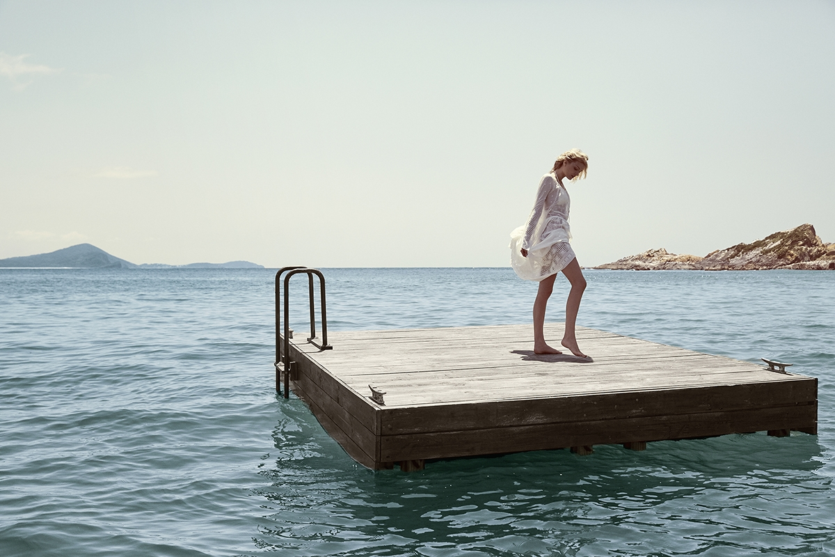 Summer Swim 16 Campaign image of Lily Donaldson stood on a jetty in the ocean