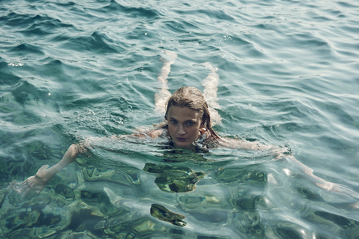 A behind the scenes shot of our model swimming in the ocean