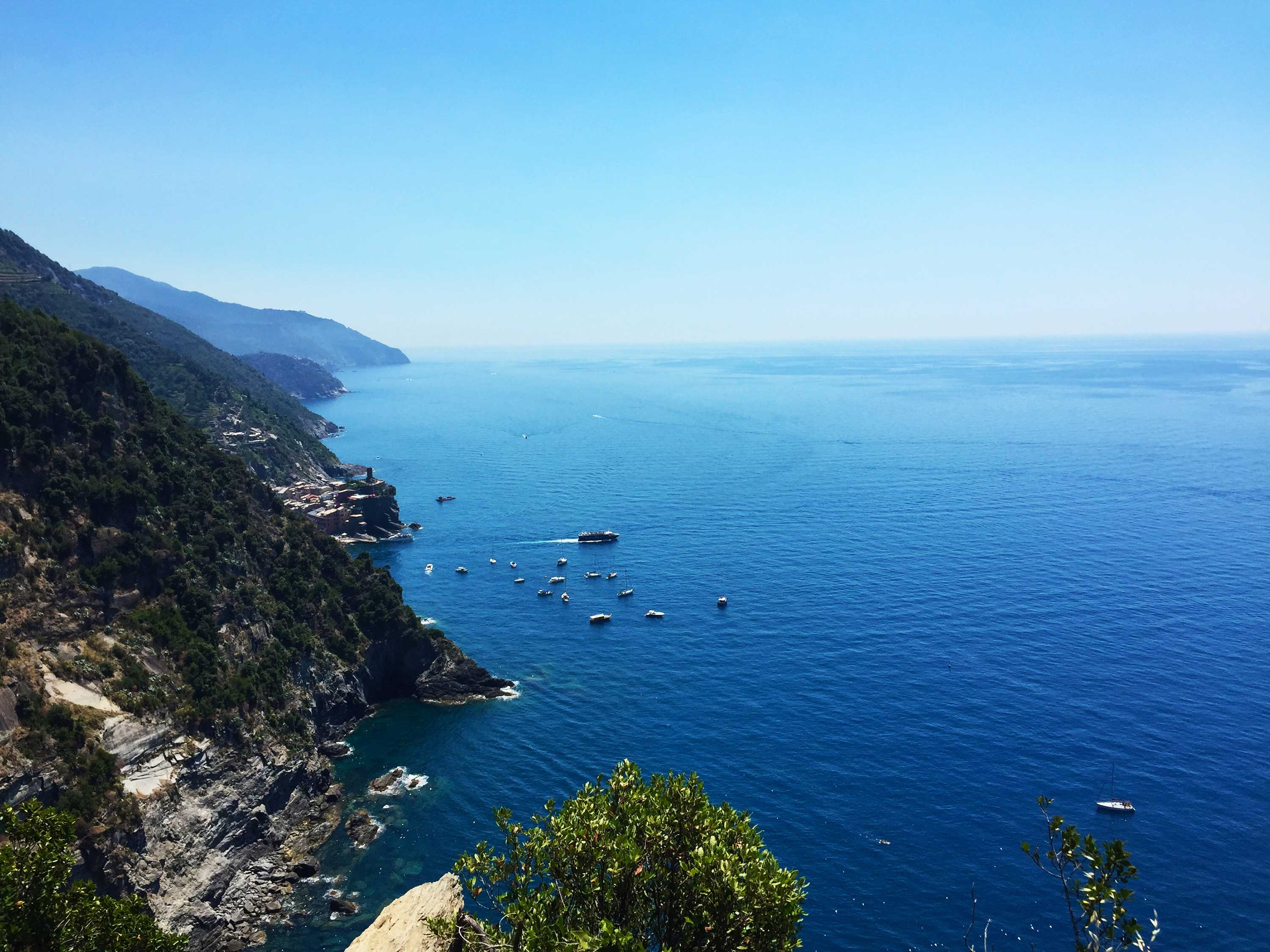 The vista of the Italian coastline – the mountains meet the sea and boats sail along the horizon