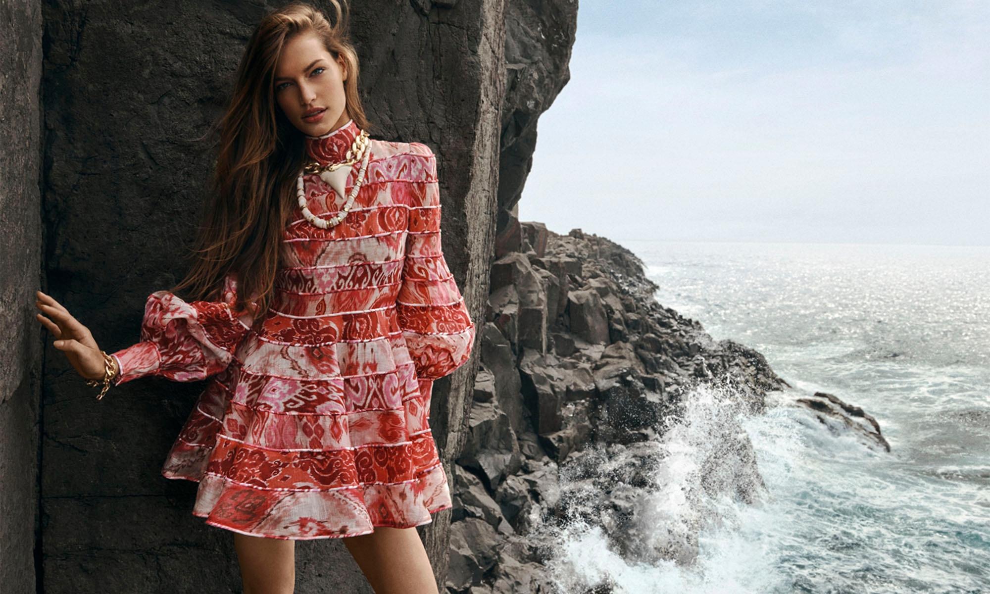 WOMAN STANDING ON THE ROCKS BY THE OCEAN WEARING Wavelength Spliced Mini, Spliced Pink Ikat