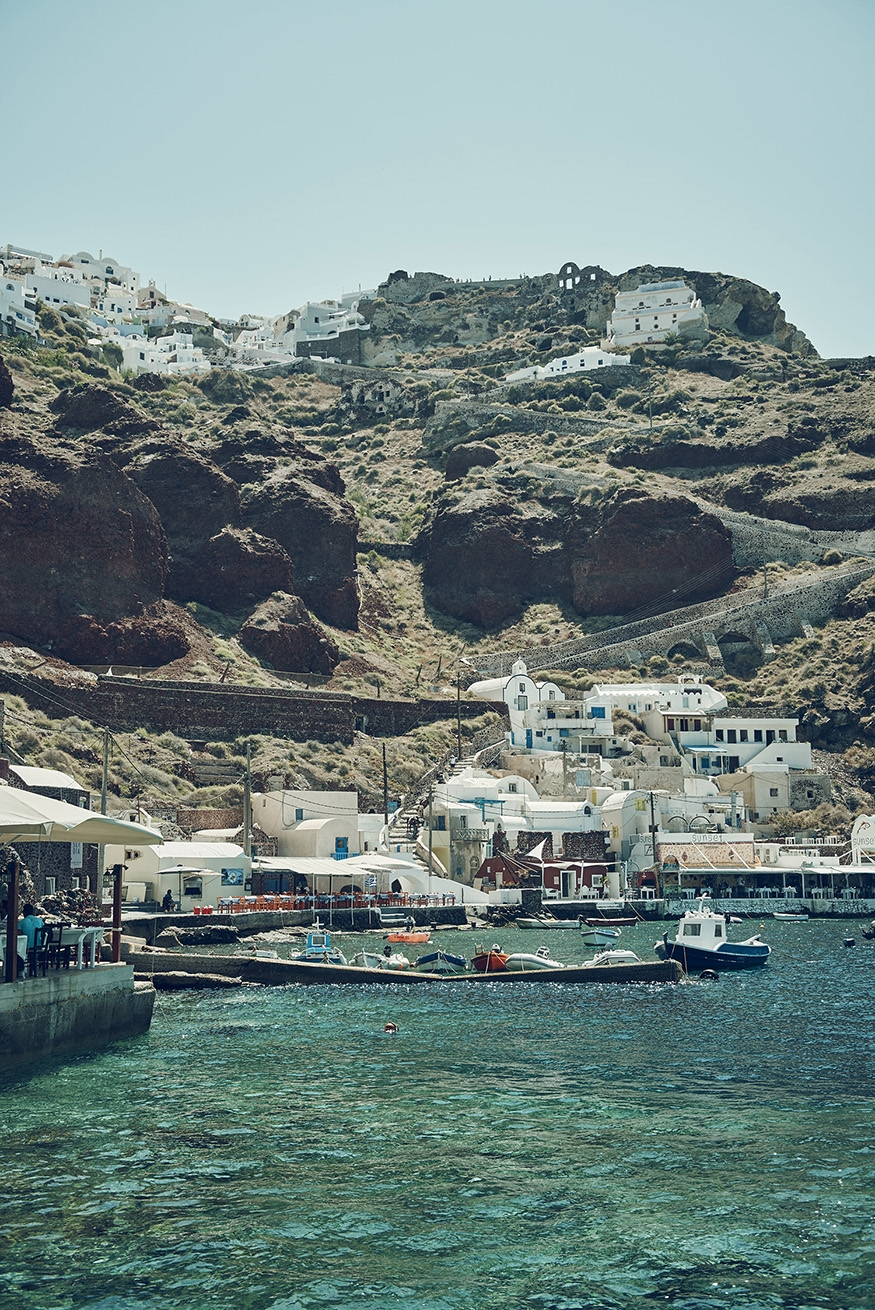 The seaside buildings, boats and docks at the bottom of a mountain