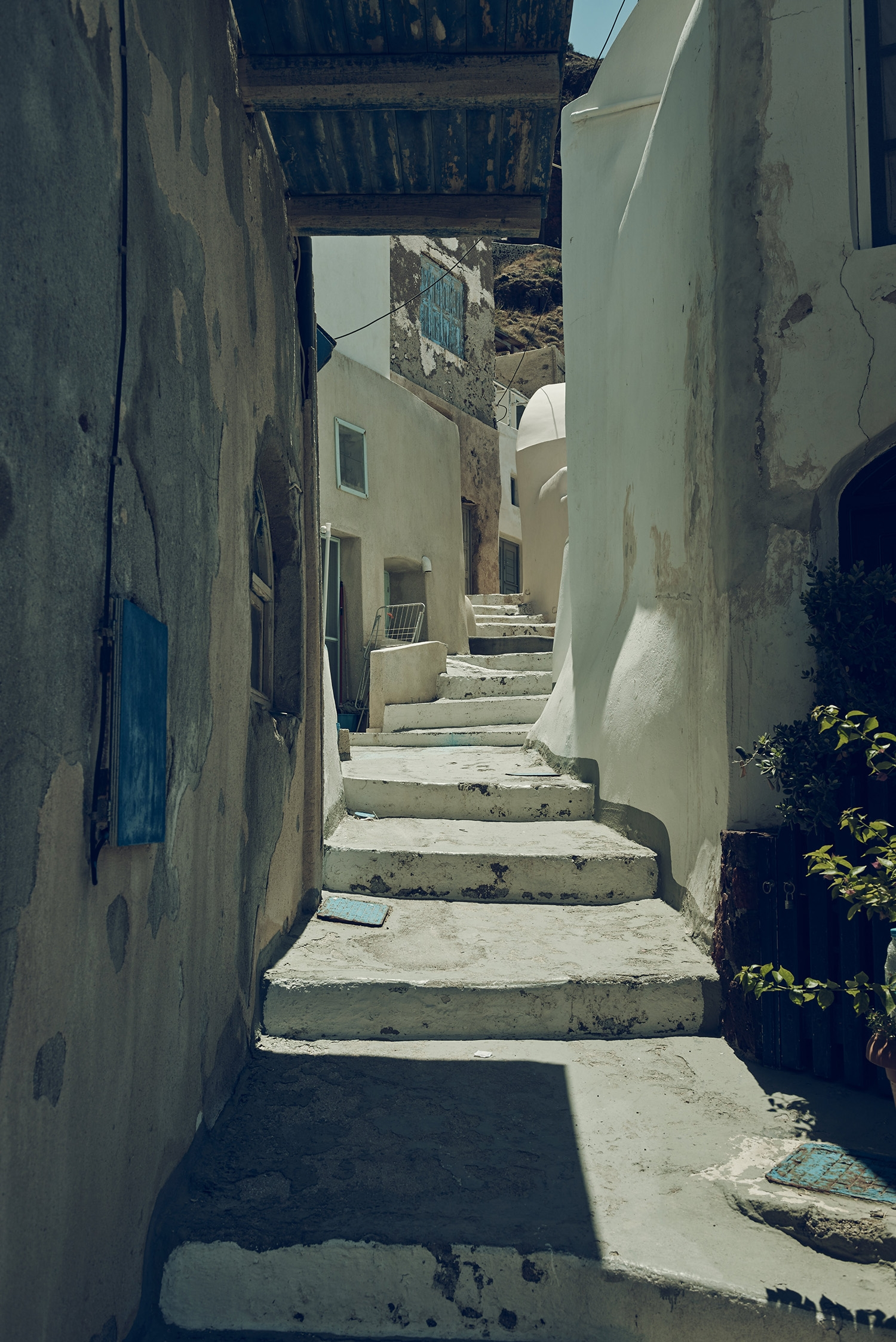 A little laneway with a stone staircase leading up the hill