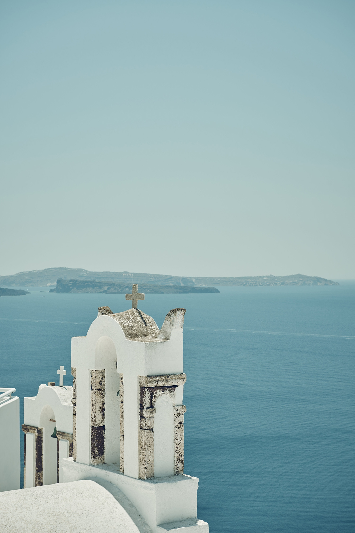 High on the mountain looking out at the roof of a chapel and the deep blue ocean