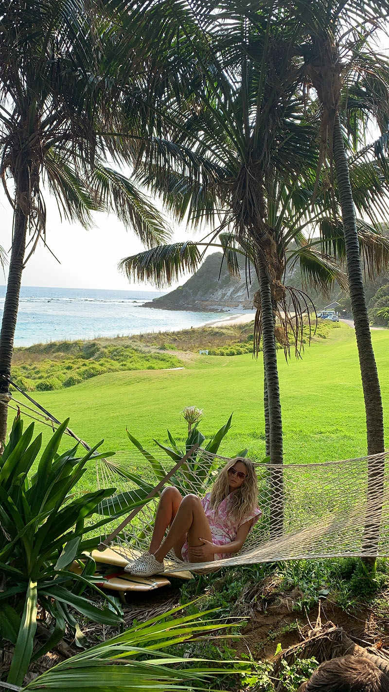 Olivia Vinten in a hammock on Lord Howe Island, the location for our Summer Swim 20 campaign