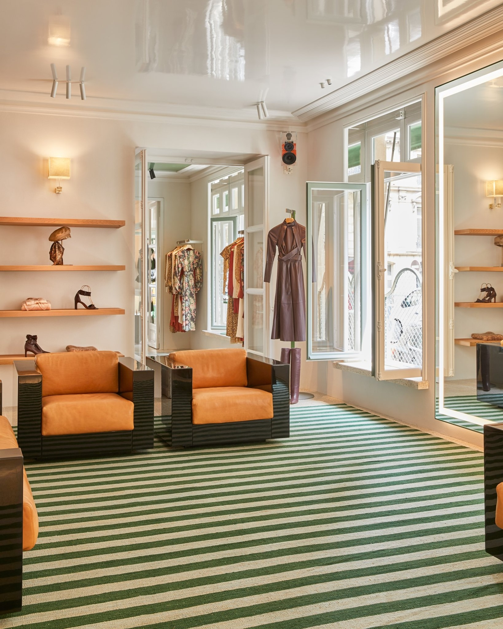 The interior of our Paris store features a minimalistic design with bright orange and green accents