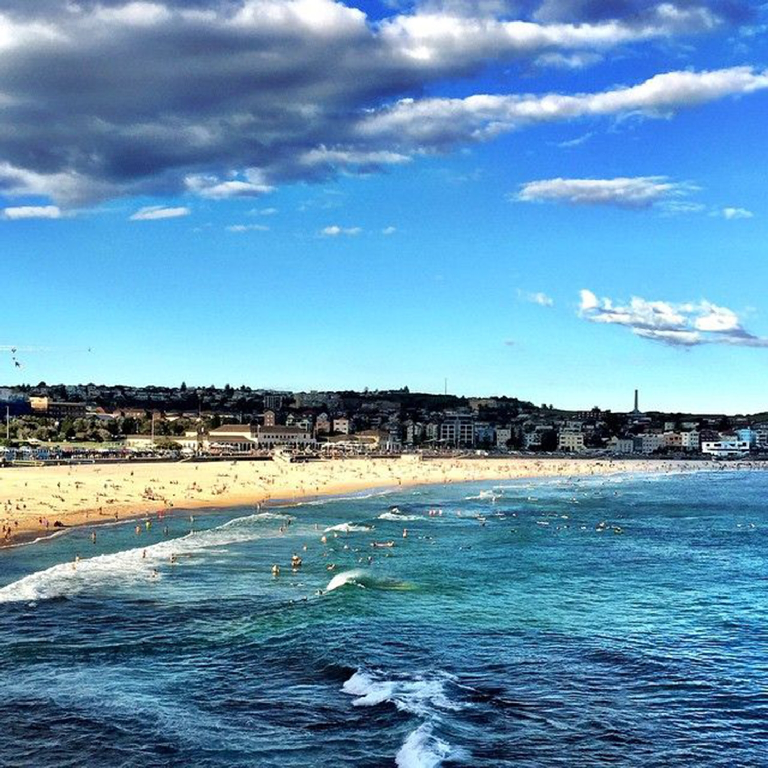 A warm evening at Bondi sees the beach filled with people – 30 degrees at 6:40pm