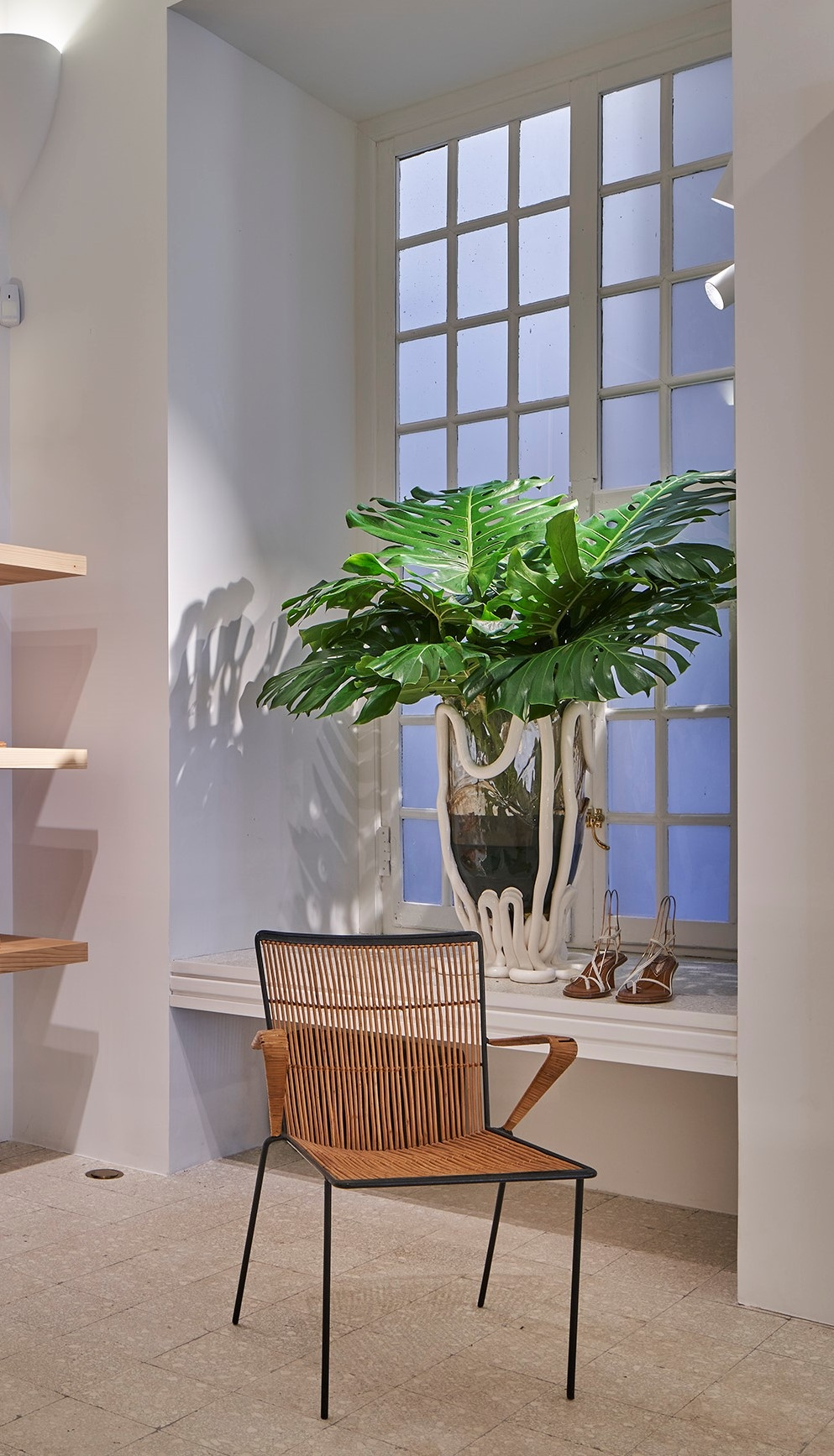 A large vase and arm chair in our Cannes store
