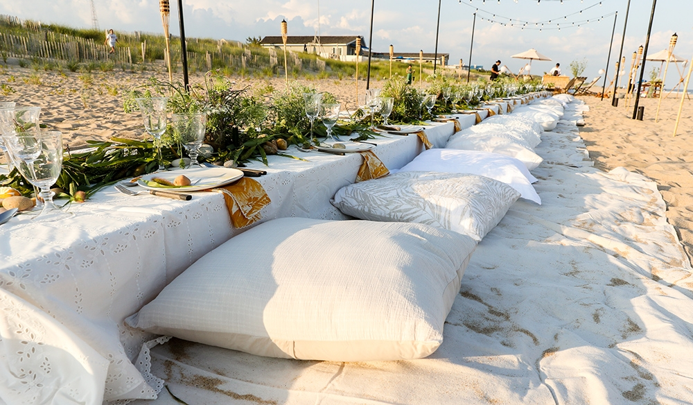 Pillows on the ground at the table