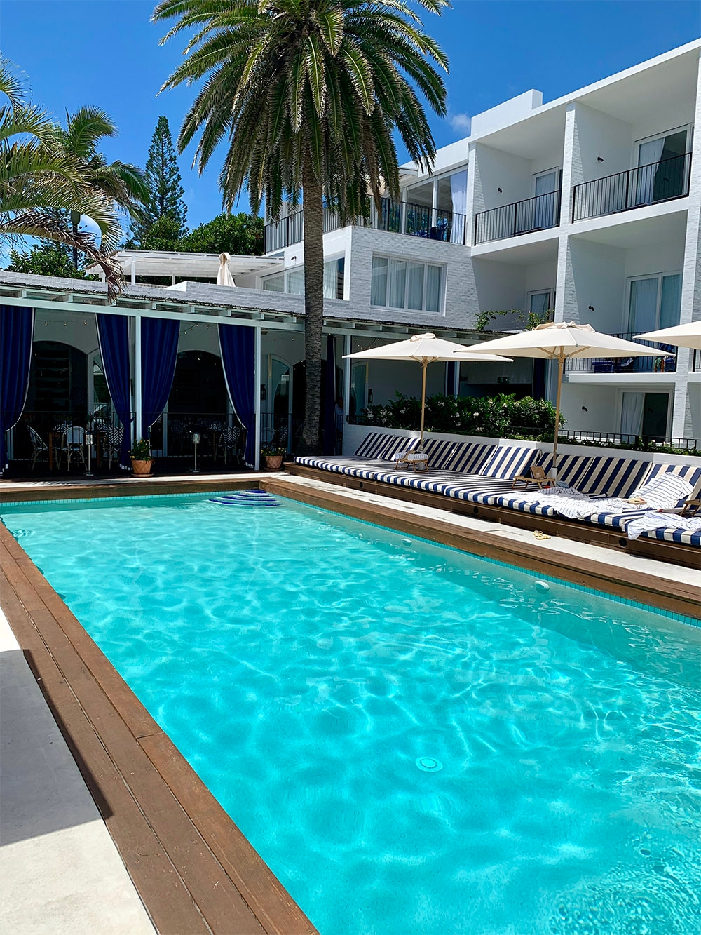 The bright blue pool at Halcyon House is invitational with its bordering sun loungers and umbrellas