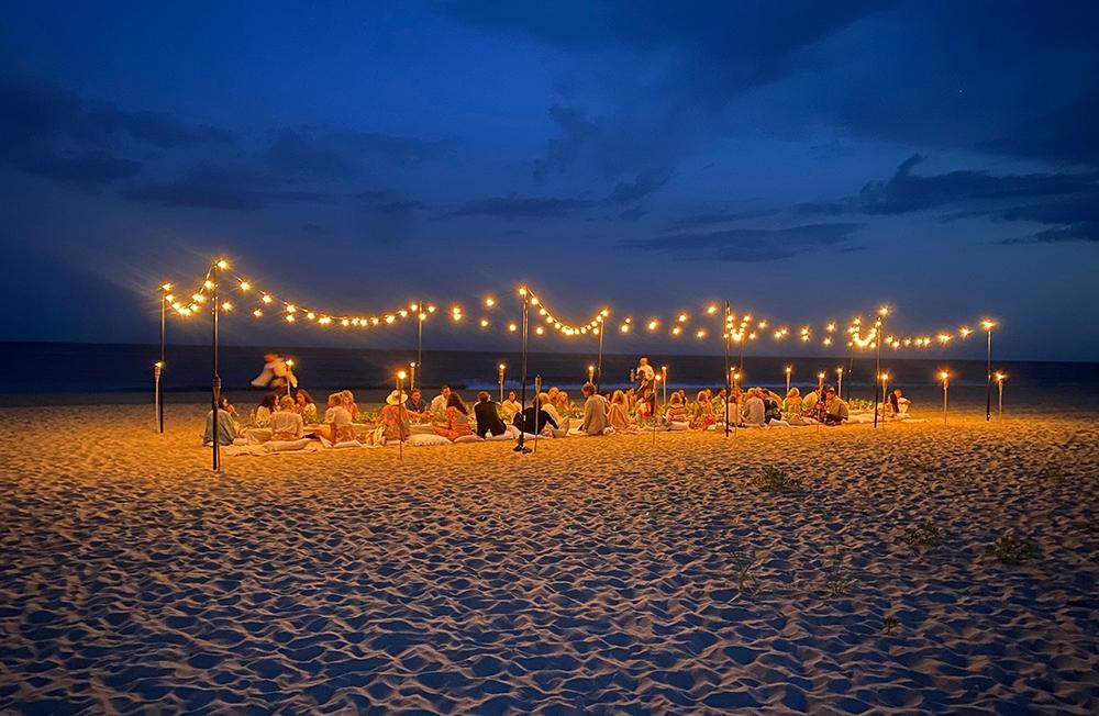 Sitting underneath the fairy lights on the beach