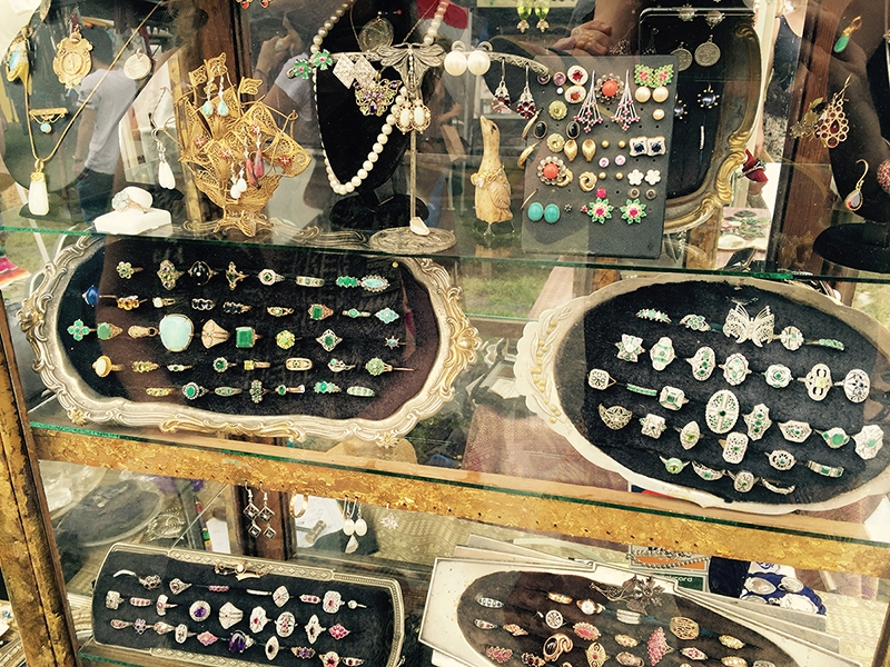 Vintage jewels in a glass cabinet at the Byron Bay markets