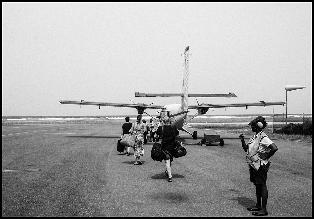 The Zimmermann team boarding a small plane on the tarmac