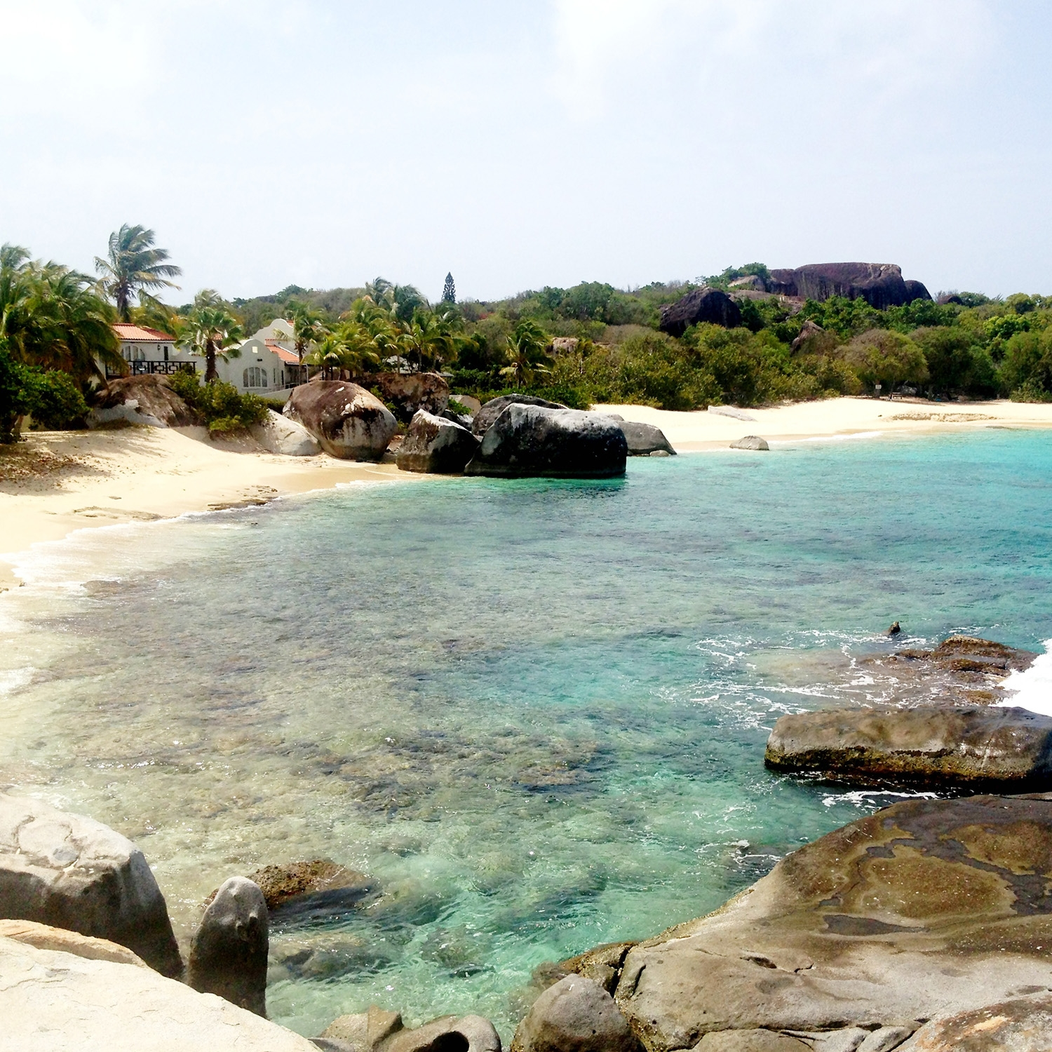 The clear water and rocky shore of Virgin Gorda