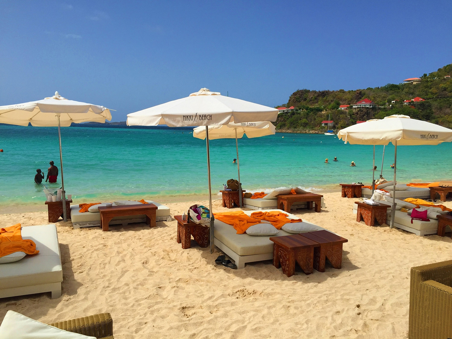 White day beds face the turquoise water on Nikki Beach