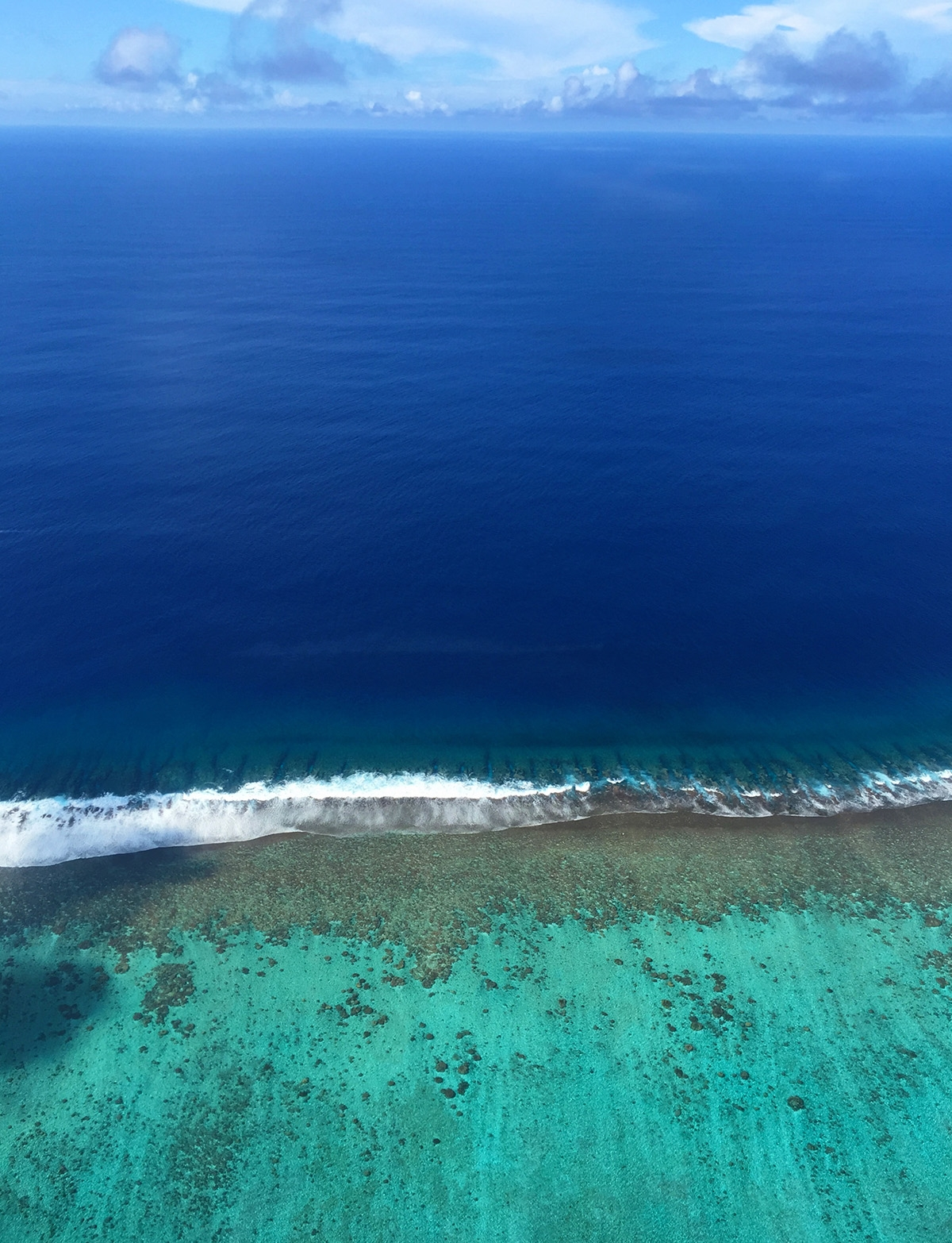 All the blues of the Bora Bora ocean from an aerial perspective