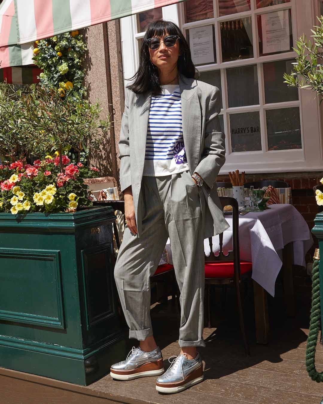 Mimi Xu in the Luminous Check Jacket and Trouser and Estelle Stripe Top