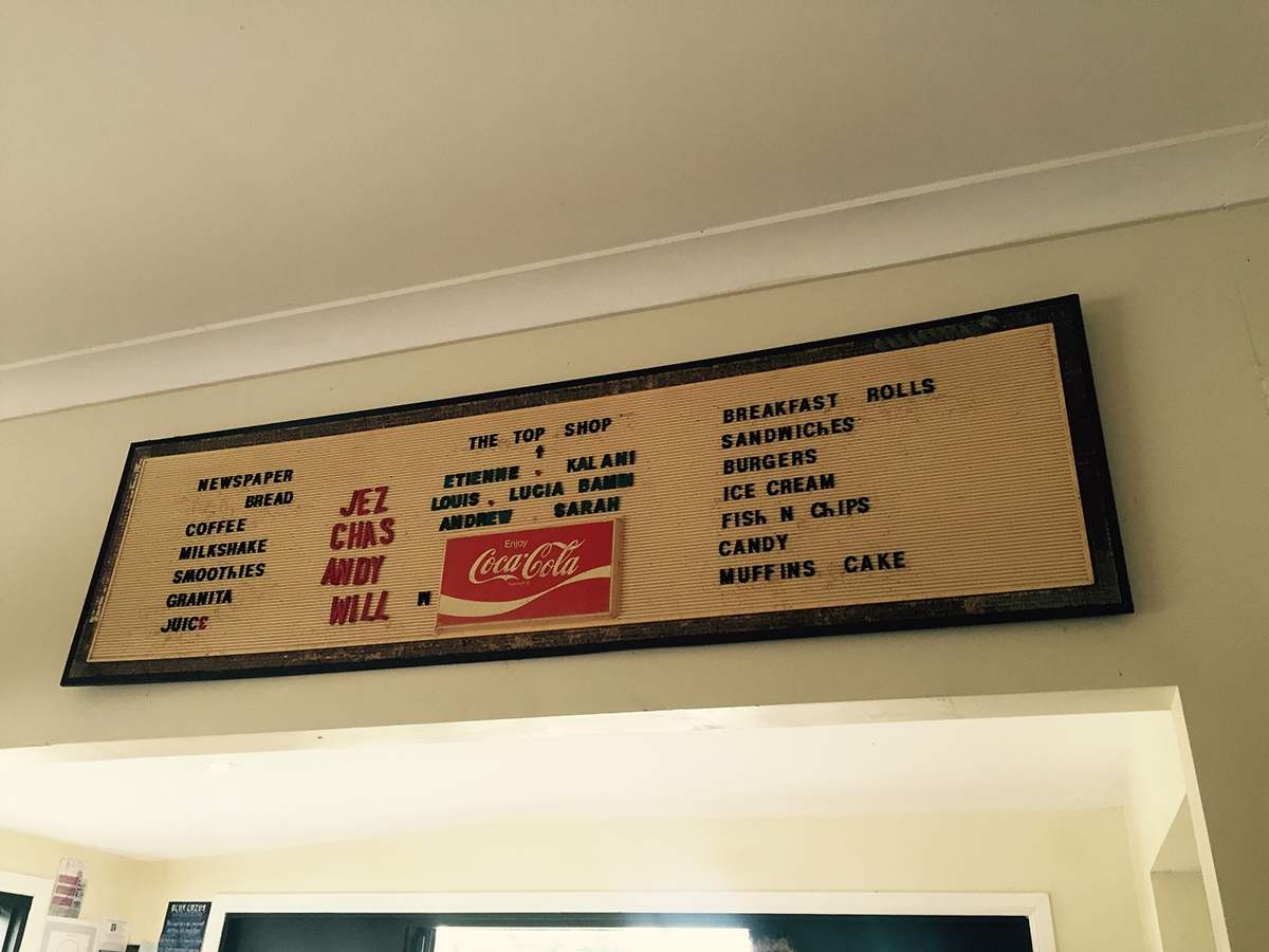 An old school menu on the wall of a takeaway store, 'The Top Shop'
