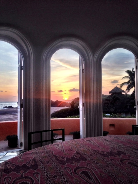 Watching the sun set over the sea through the arched doorways at Casa Playa