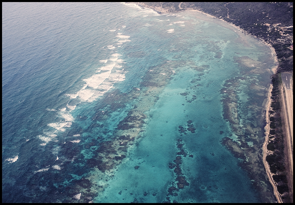 A view of the reefs and coastline from above