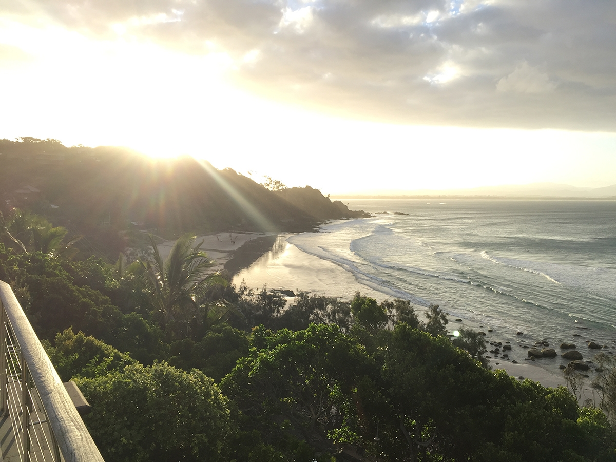 The view of the sunset behind Wategos beach from atop a mountain