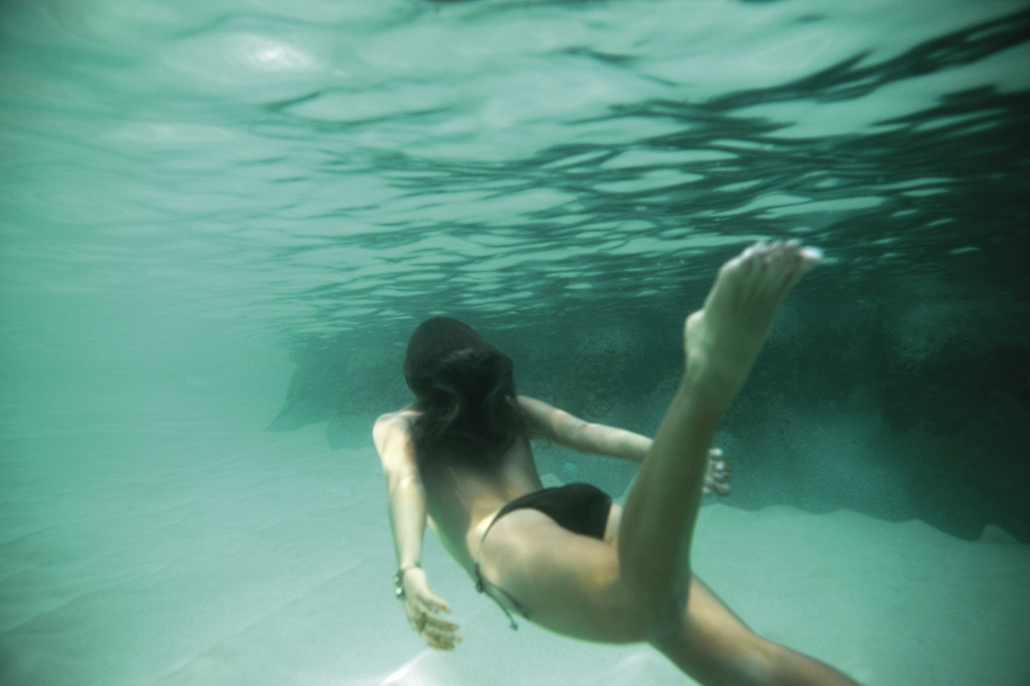 Our model swims topless underwater