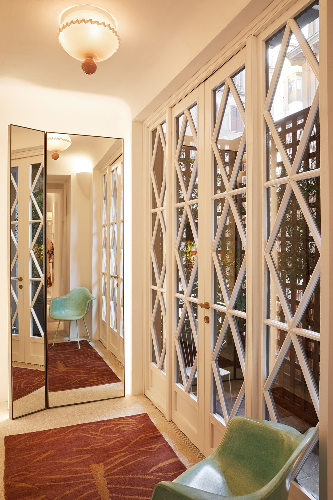 Glass doors to a courtyard in our Rome boutique