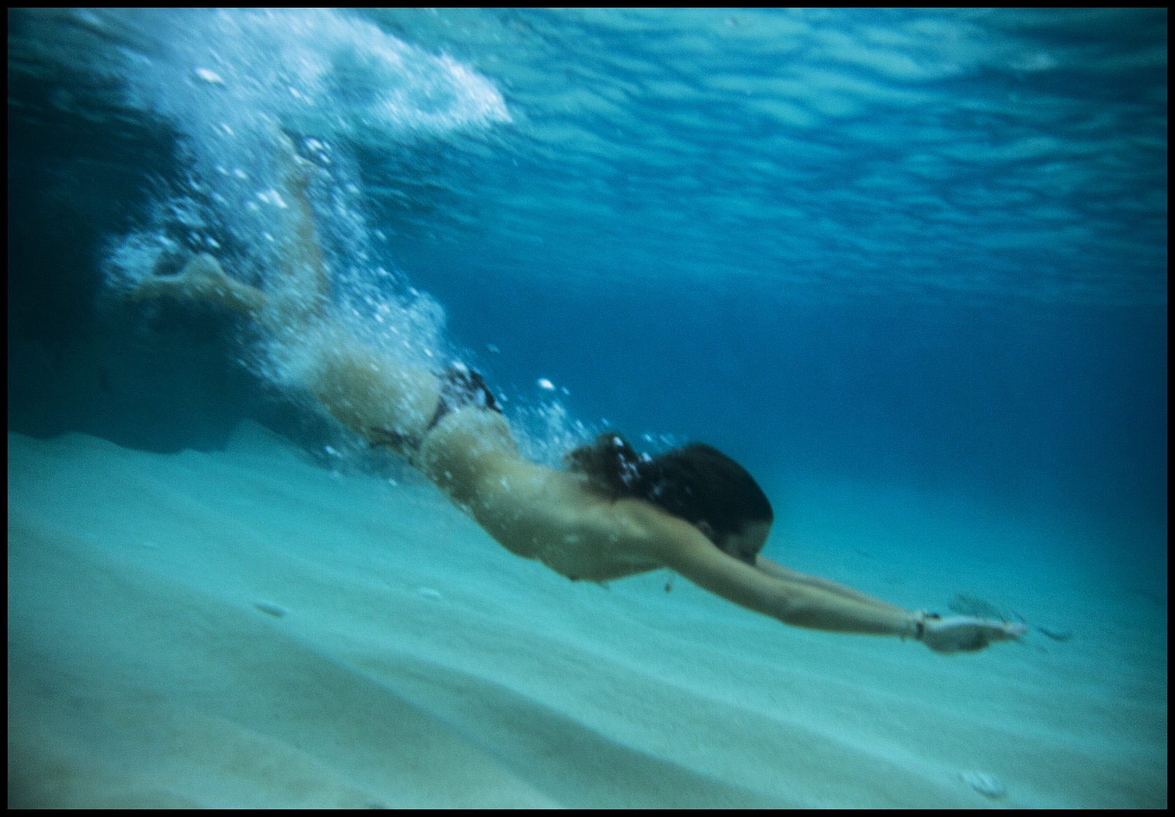 Our model dives underwater and swims adjacent to the ocean's floor