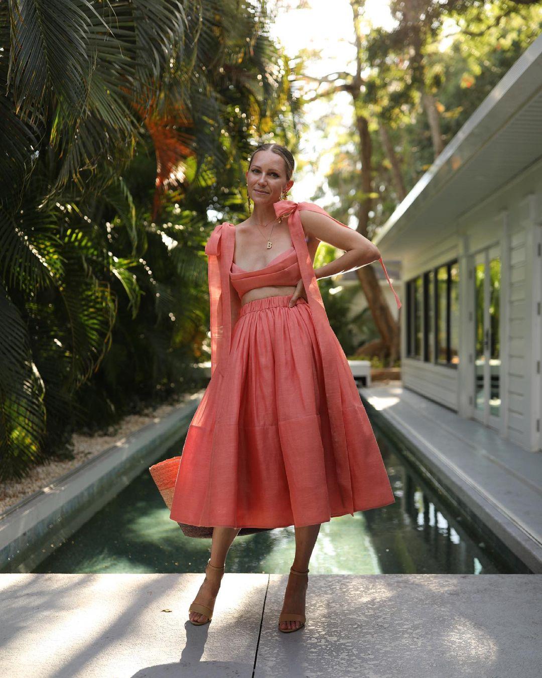Blair Eadie wears the Botanica Tie Bustier and Midi Skirt