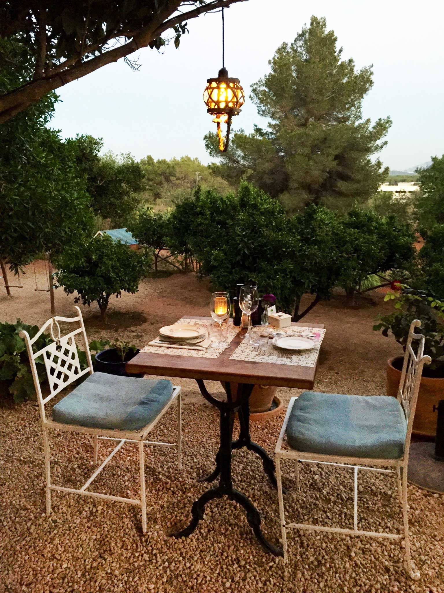 A table set for two for an intimate outdoor dinner at La Paloma