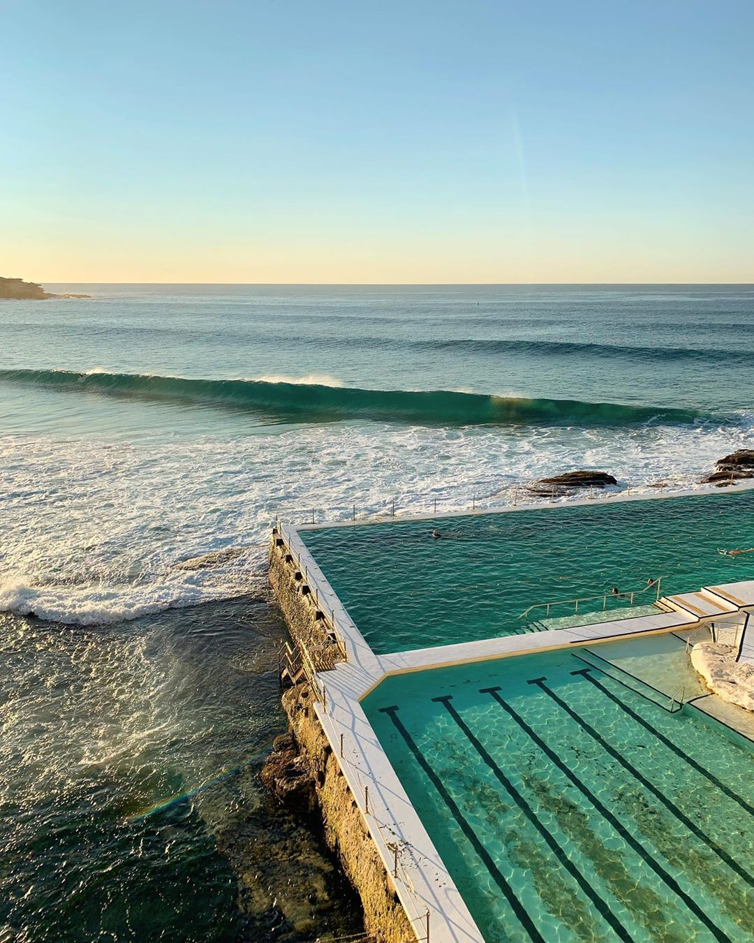 The waves rolling in next to the Bondi Icebergs