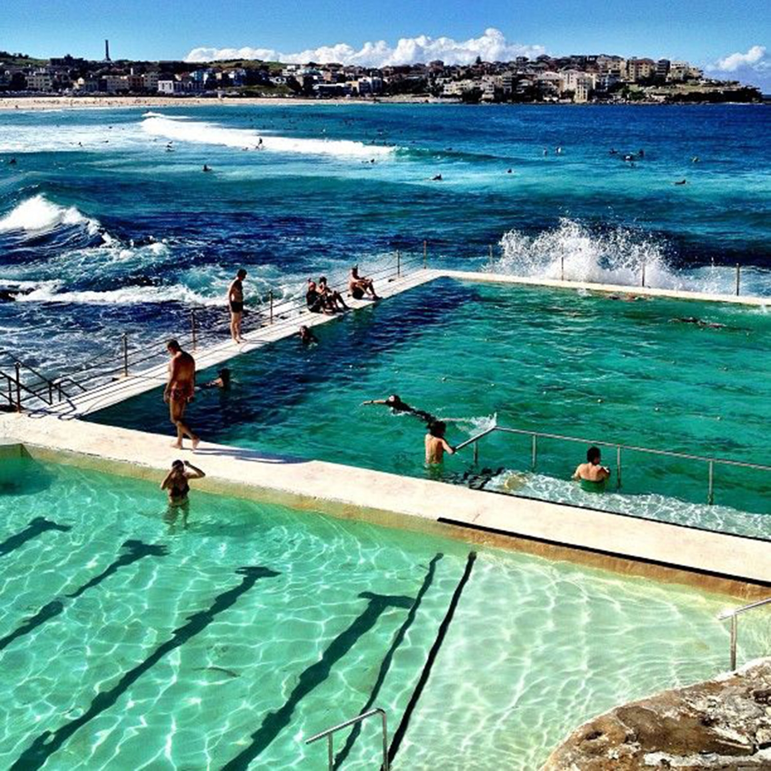 Swimmers enjoying the pool and ocean on Mother's Day at Bondi