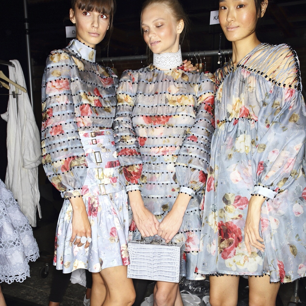 Three models in a behind the scenes picture from Spring 16