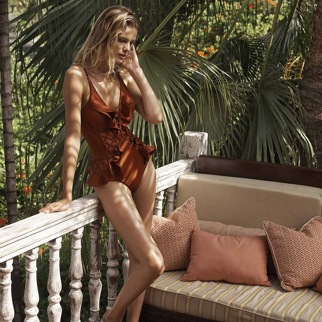 An image from the Resort Swim 17 Campaign of Eden on a balcony at Cotton House