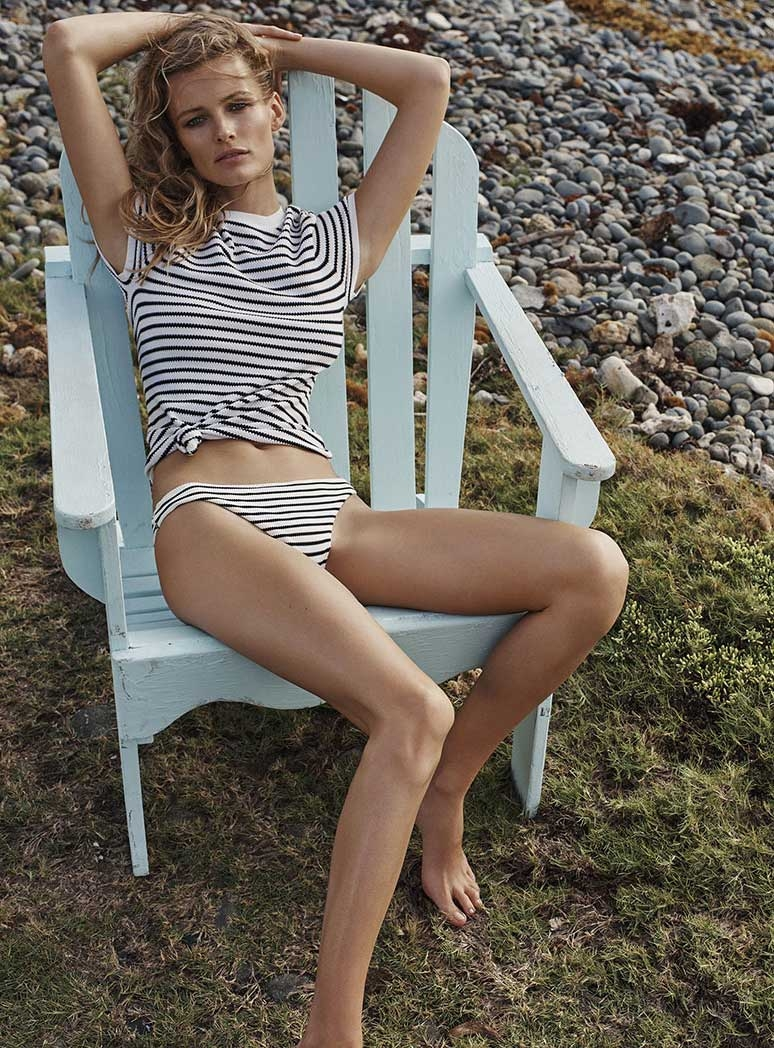 An image from the Resort Swim 17 Campaign of Eden on an outdoor chair