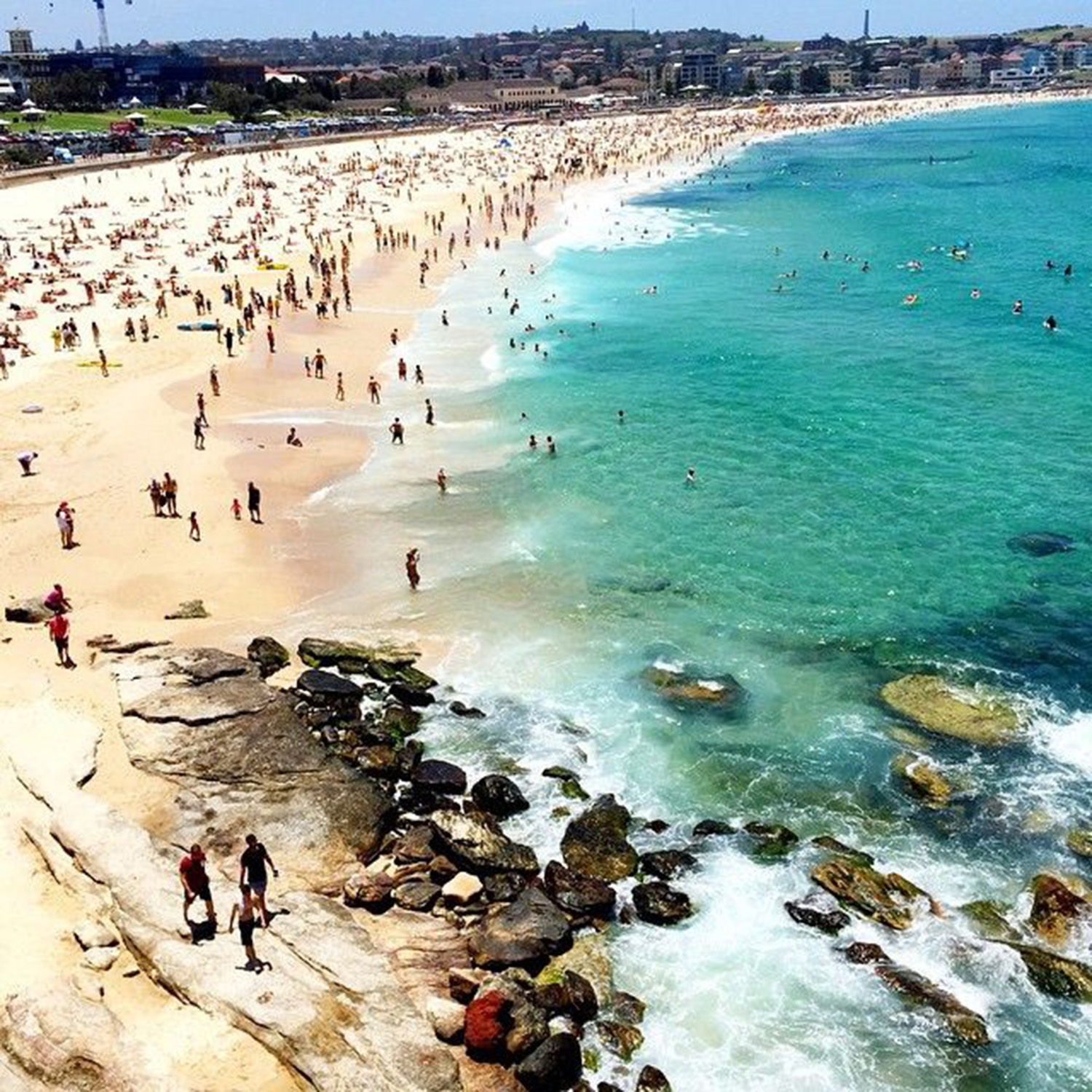 Christmas Day at Bondi sees beachgoers enjoying the sand and sea
