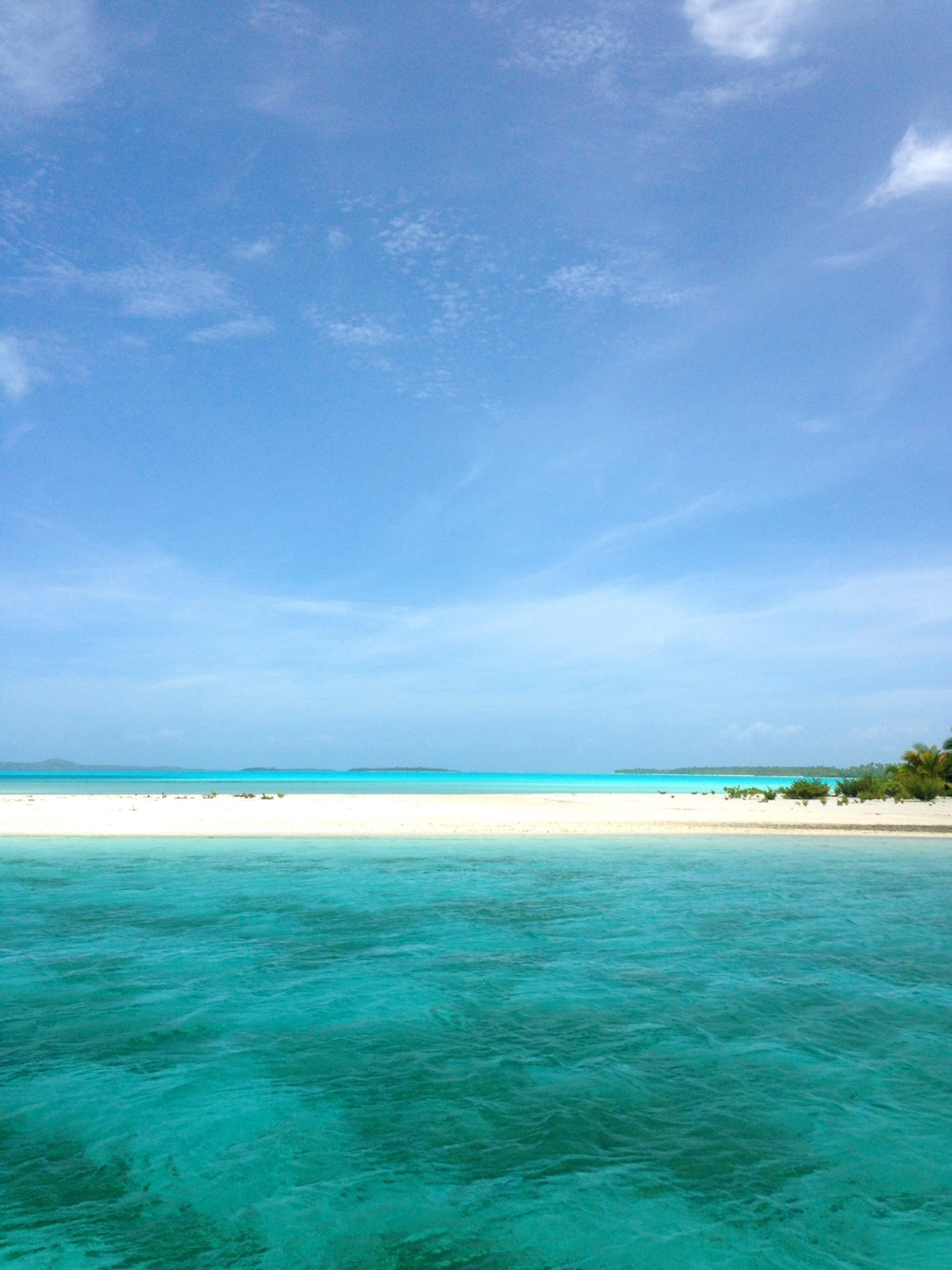 The crystal blue water and white sandy beaches of the Cook Island landscape