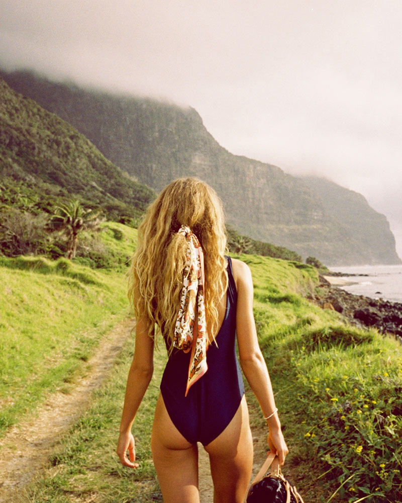 Olivia Vinten with the mountains of Lord Howe Island, the location for our Summer Swim 20 campaign