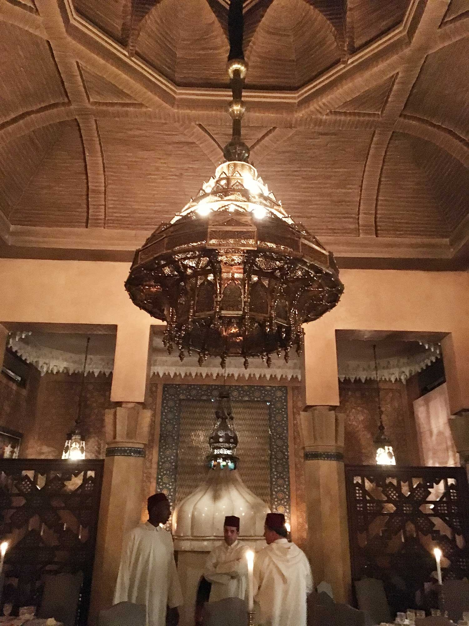 A large gold chandelier hangs in the Dar Yacout