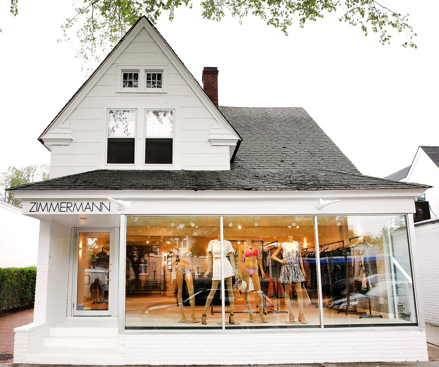 The white exterior and glass front of our East Hampton store
