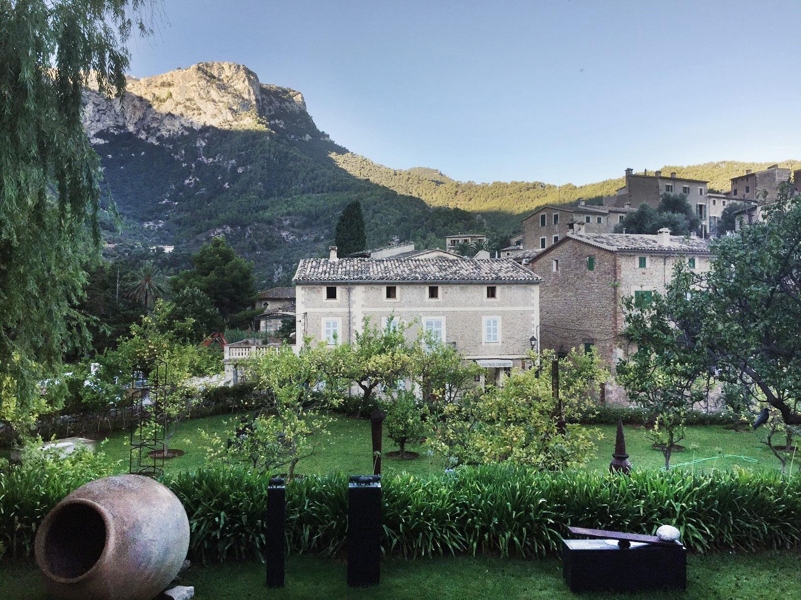 Rocky mountain terrain flanks the lush olive groves at Deia