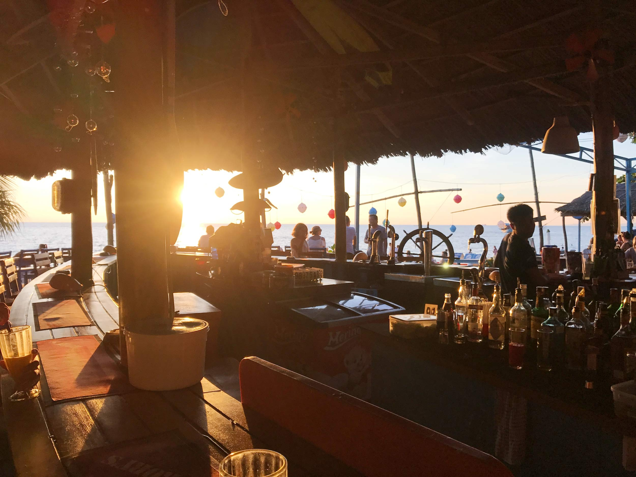 Rory's Beach Bar sits by the water and is sun kissed as the evening rolls in
