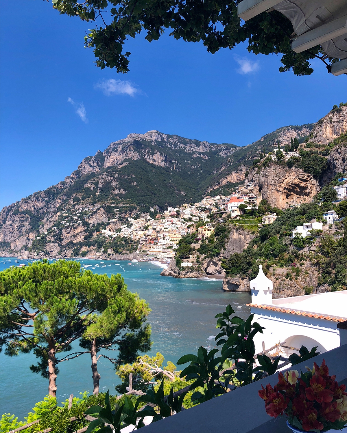 The view from Villa Tre Ville boasts turquoise water and colourful houses built into the mountain
