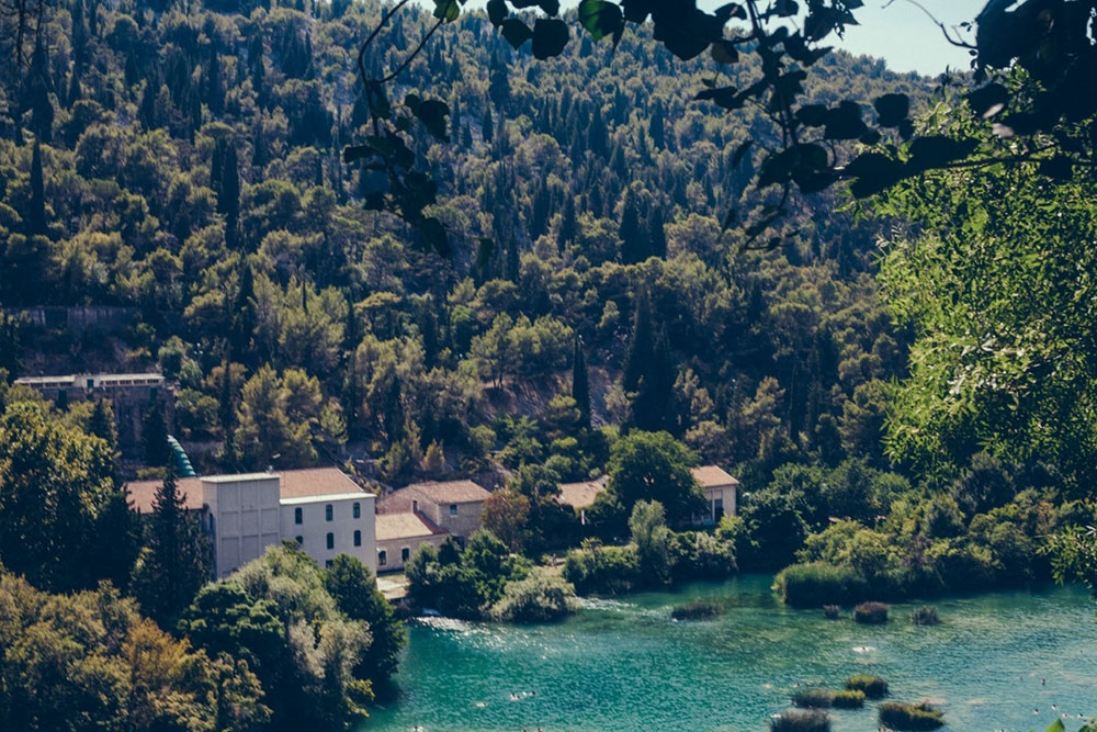 Green hills and turquoise waters in Krka National Park – Split