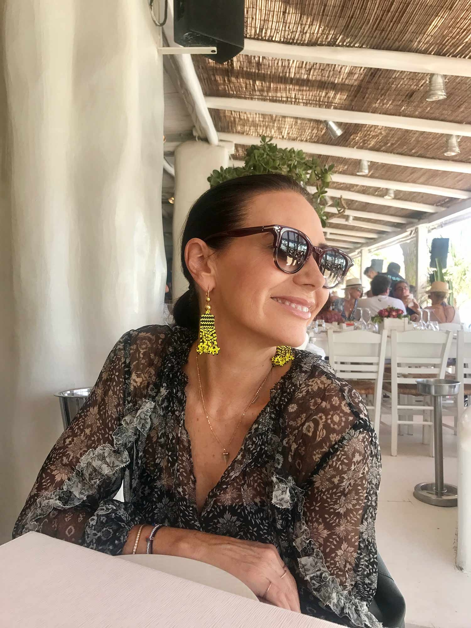Nicky Zimmermann wearing vibrant holiday earrings. July 2017